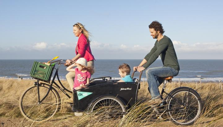 Famliy bicycling in the dunes