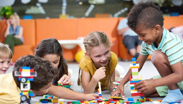 Diverse group of children playing with Lego